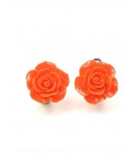 Oranje oorclips in de vorm van een roosje