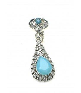 Zilverkleurige oorclips met blauwe facet kraal en heldere strass steentjes