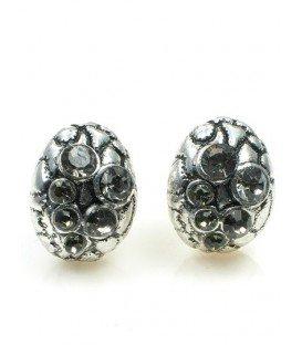 Metaalkleurige oorclips met grijze strass steentjes