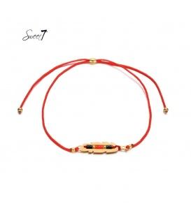 Rode elastische armband met goudkleurig detail met kleine kraaltjes