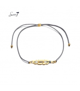 Grijze elastische armband met goudkleurige detail met kleine kraaltjes