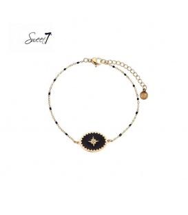 Goudkleurige armband met zwarte kraaltjes en bedel met ster