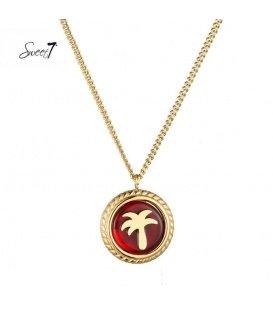 Goudkleurige ketting met ronde rode bedel met palmboom