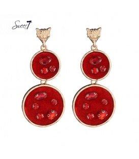 Goudkleurige oorbellen met twee hangende platte rode cirkels