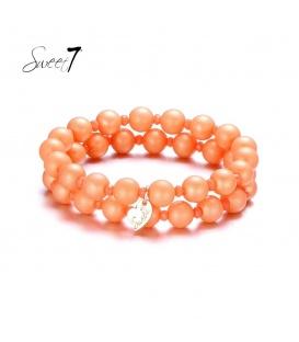 Armbanden met grote en kleine oranje kralen