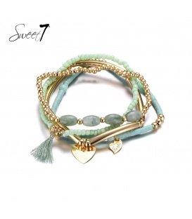 Set van armbanden met goudkleurige en groene kralen en een kwastje