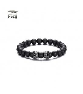 Elastische armband met zwarte kralen en twee zilverkleurige details