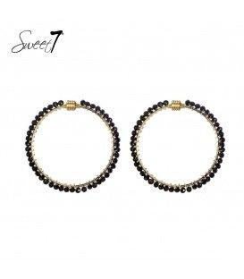 Goudkleurige ronde oorbellen met zwarte steentjes