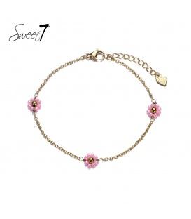 Goudkleurig enkelbandje met drie roze bloemetjes