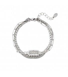 Zilverkleurige armband met drie kettingen en een hanger met maan en sterren