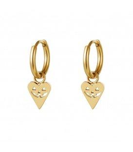 Goudkleurige oorbellen in de vorm van een hart met een pompoen gezicht