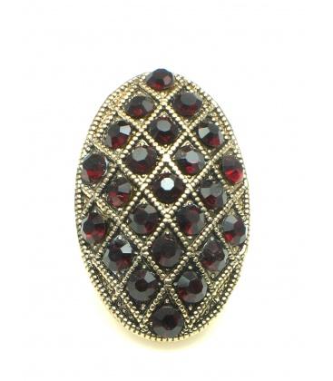 Mooie ovale goudkleurige oorclips met rode strass steentjes