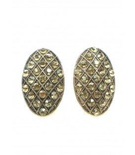 Mooie ovale goudkleurige oorclips met gele strass steentjes